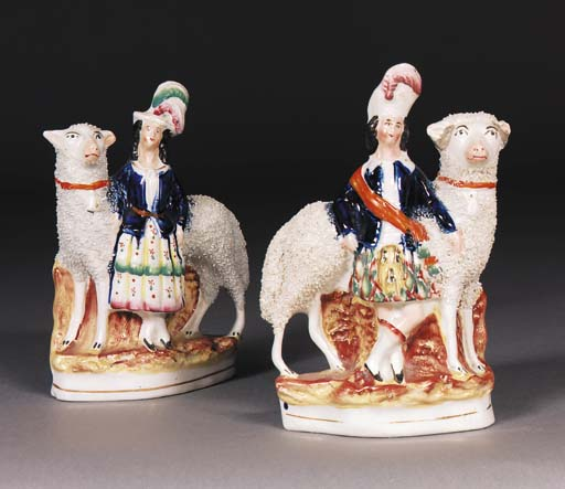 A pair of Staffordshire models of children and sheep