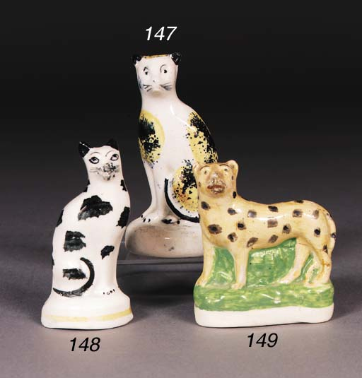 A Staffordshire model of a cat