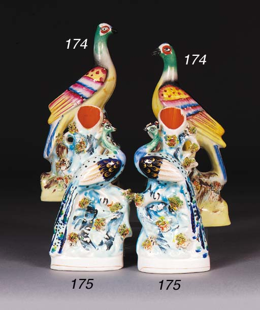A pair of Staffordshire peacoc
