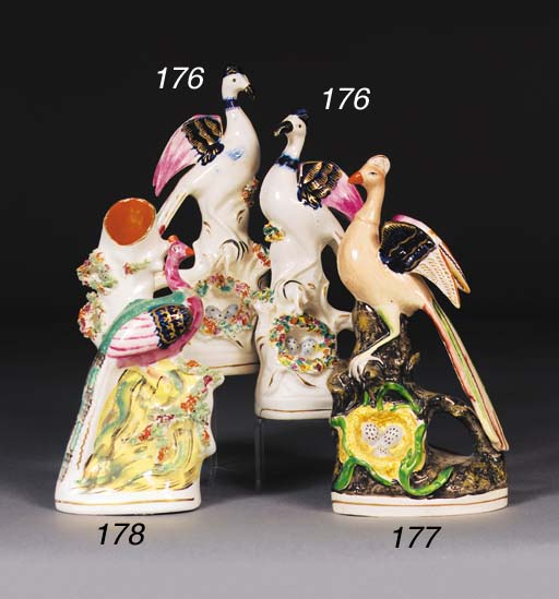 A pair of Staffordshire exotic