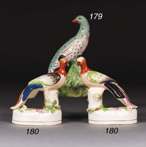 A pair of Staffordshire exotic bird penholders