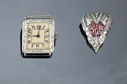 A lady's diamond watch and a diamond and gem brooch,