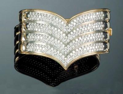 A diamond set bangle,
