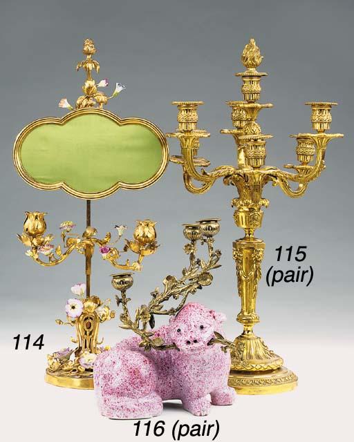 A pair of gilt bronze seven light candelabra, 20th century