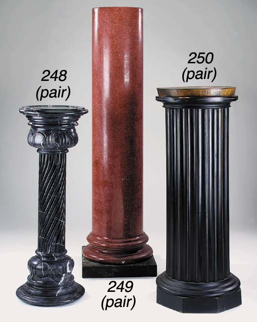 A pair of ebonised and varnished wood columnar pedestals, 20th century