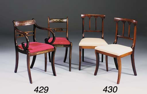 A set of six Regency grained beech and brass inlaid dining chairs and two later mahogany armchairs