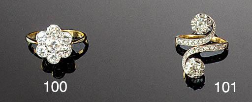 A diamond and rose-cut diamond cross-over ring