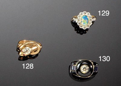 A diamond and gem serpent ring