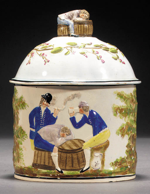 A pearlware tobacco jar and co