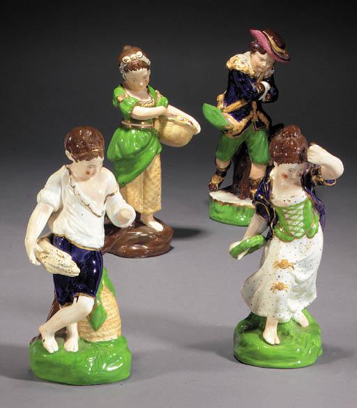 A set of four porcelain figure