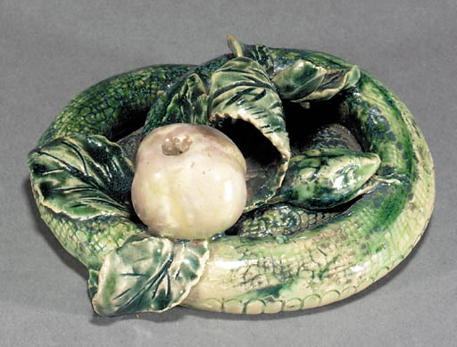 A Lambeth stoneware figure of a snake and apple