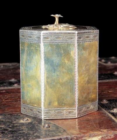 A GEORGE III SILVER-GILT TEA C