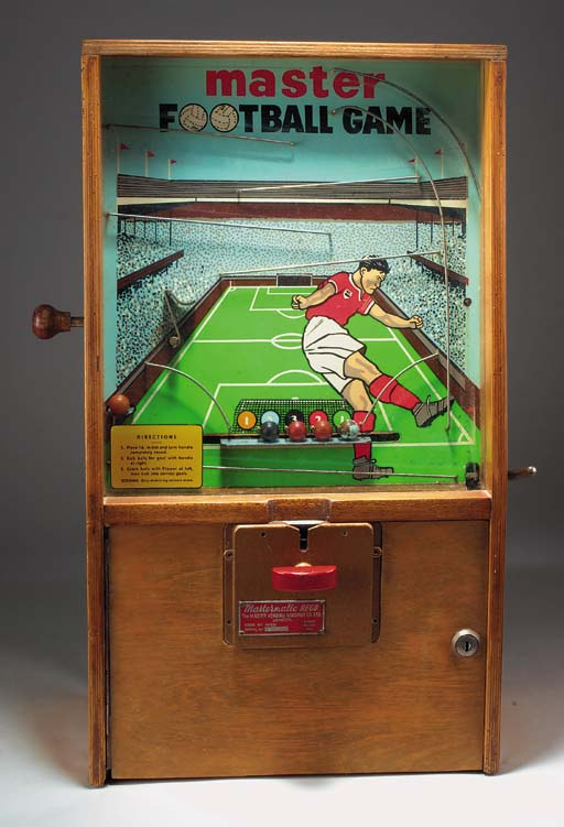 A table-top Master Football Game vending machine, bearing a plaque, inscribed Mastermatic Regd, The Master Vending Machine Co. Ltd
