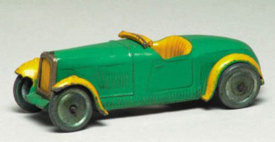 A pre-war Dinky green and yell