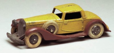 A pre-war Dinky tan and brown