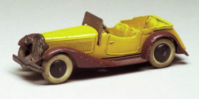 A pre-war Dinky yellow and bro