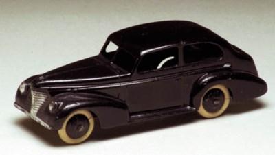 A pre-war Dinky black 39b Olds