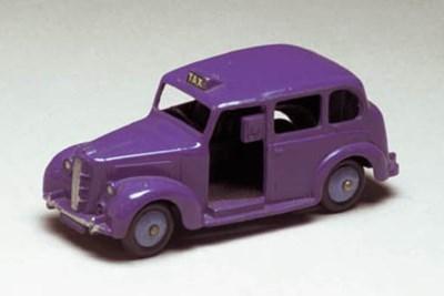 A Dinky blue 254 Austin Taxi