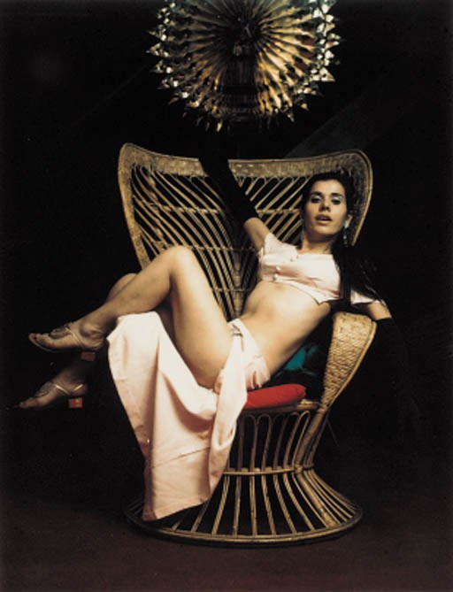 Carlo Mollino (1905-1973), Polaroid, c. 1963-65. Model reclining in wicker chair. Sold for £4,700 on 23 October 2001 at Christies in London