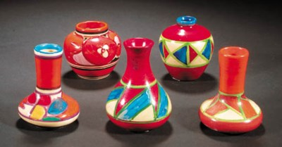 A selection of nine mini vases