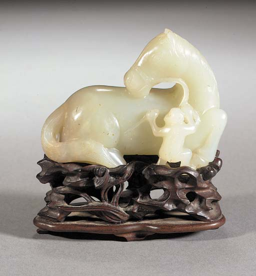 A pale celadon jade carving of a recumbent horse 18th Century