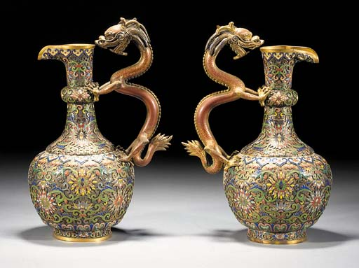 A pair of gilt bronze enamelled ewers 18/19th Century