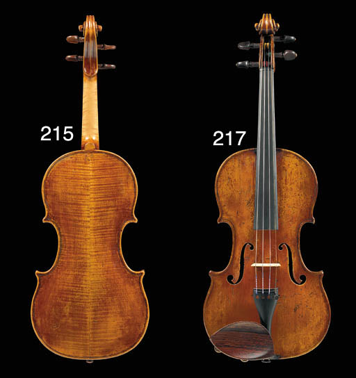 A violin, attributed to Charles Adolphe Maucotel, labelled Charles-Adolphe MAUCOTEL/Gallerie Vivienne Paris 18, the two-piece back of medium curl, the varnish of a orange-gold colour, the length of back 14 1/8in (358mm) (2)
