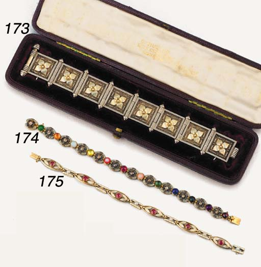 A late 19th century gold, white enamel and ruby bracelet