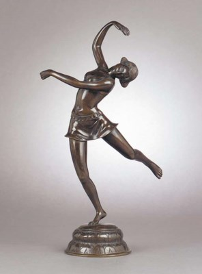 An patinated bronze figure