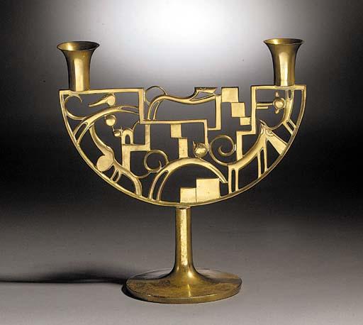 A Hagenauer brass candelabra