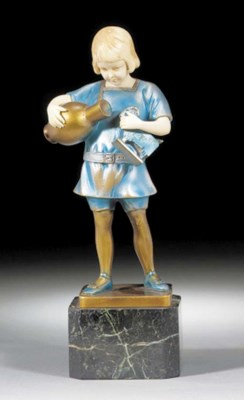 A cold-painted and ivory figur