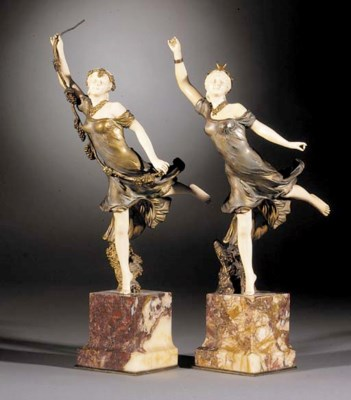 A pair of gilt and cold-painte