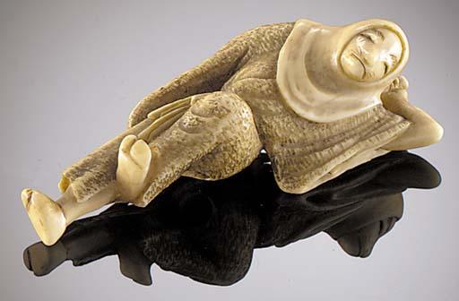 An ivory netsuke of a fox-woma
