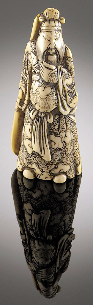 An ivory netsuke model of Kwan