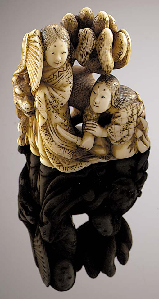An ivory netsuke of two female
