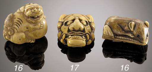 An ivory demon mask netsuke Ci