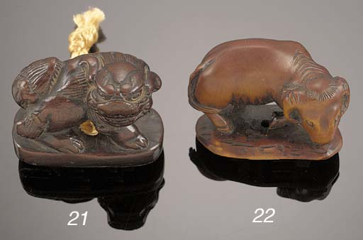 A wood netsuke of a ram 19th C