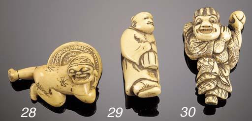 An ivory netsuke of an old man