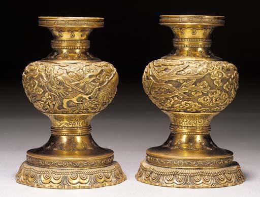 A pair of gilt-bronze candlest