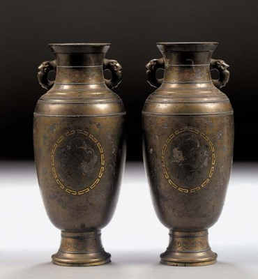 A pair of bronze baluster vase