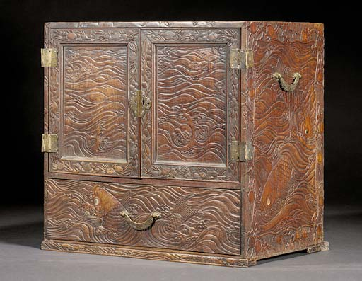 A carved wooden rectangular ta