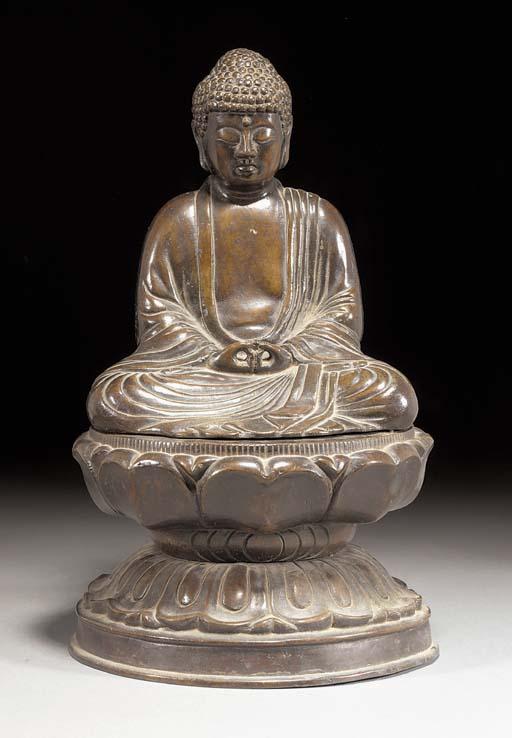 A bronze model of Buddha upon