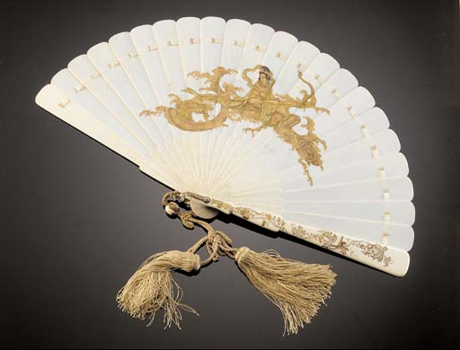 An ivory and gold lacquer fan