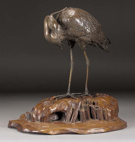 A bronze model of an egret Mei