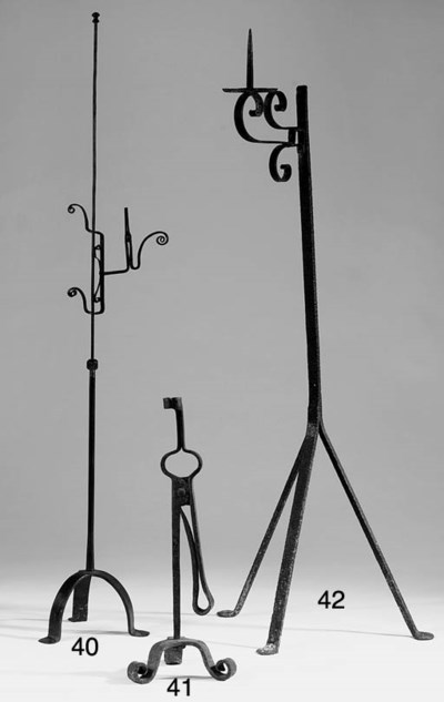 A wrought iron candle holder,