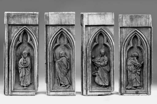 A set of four carved limewood