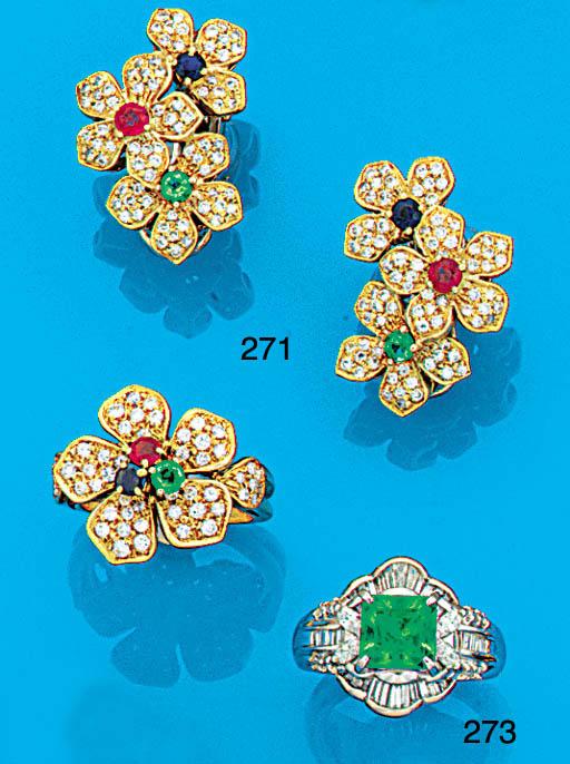 An emerald, diamond and fancy cut diamond ring,