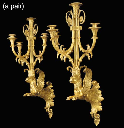A pair of Empire style four light wall appliques, of recent manufacture