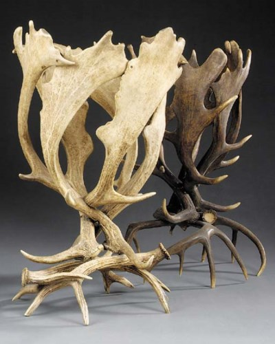 Two antler jardiniere stands,