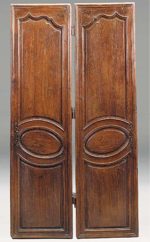 A PAIR OF LOUIS XIV/REGENCE OAK ARMOIRE DOORS